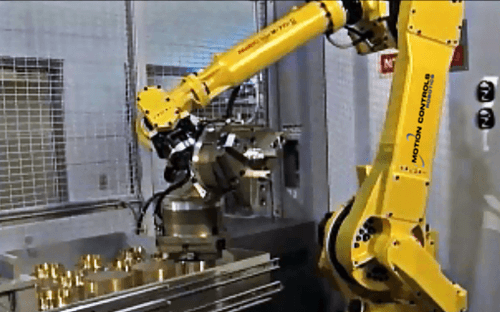 This M710 series robot is being used for CNC tending using a set of drawers for raw and finished parts. Click on the image to watch the video